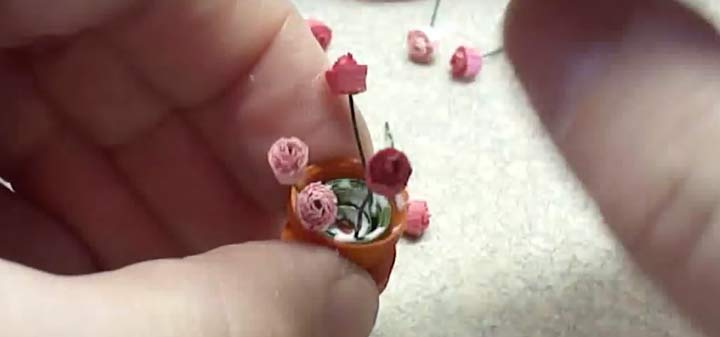 adding quilled paper miniature flowers
