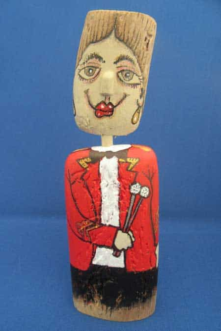timpani driftwood figure red female